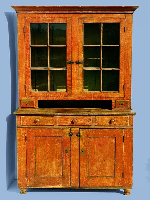 Charming PENNSYLVANIA DUTCH CUPBOARD IN BITTERSWEET ORANGE PAINT, WITH VINEAGR  DECORATION, ON TURNED FEET,