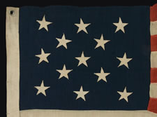 "13 STARS IN A 3-2-3-2-3 CONFIGURATION ON A SMALL SCALE FLAG WITH ""SQUARISH"" PROPORTIONS, 1895-1926"