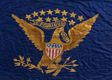 """SILK, CIVIL WAR BATTLE FLAG WITH """"GREEN MOUNTAIN BOYS"""" GILT-PAINTED IN WHIMSICAL SERPENTINE TEXT, INSIDE A RING OF 20 STARS THAT EXCLUDES THE SOUTHERN STATES, WITH A FEDERAL EAGLE ON THE REVERSE; APPARENTLY DISPLAYED POST-WAR, AT WHICH TIME A PAINTED PORTRAIT OF GEORGE WASHINGTON WAS APPLIED OVER THE UNIT NICKNAME; THIS ALMOST CERTAINLY OCCURRED IN 1877, WHEN A GIANT CELEBRATION WAS HELD TO COMMEMORATE THE 100-YEAR ANNIVERSARY OF THE BATTLE OF BENNINGTON (VERMONT), AND HONOR A VISIT OF PRESIDENT"""