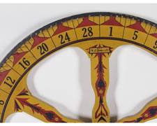 GAME WHEEL IN CHROME YELLOW PAINT WITH DECORATION REMINISCENT OF AMERICAN INDIAN ART, CHICAGO, 1910-20