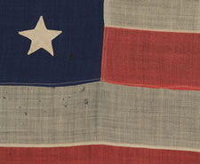 "38 HAND-SEWN, SINGLE-APPLIQUED STARS ON A FLAG MADE BY ANNIN IN NEW YORK CITY, COLORADO STATEHOOD, 1876-1889, SIGNED ""G. SCHENK, 1881"""