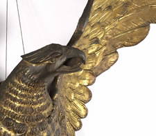 LARGE AND IMPRESSIVE PRESSED BRASS EAGLE, AN EARLY PARADE FLAG HOLDER & BUNTING TIE-BACK, MADE IN NEW YORK, PATENTED 1891