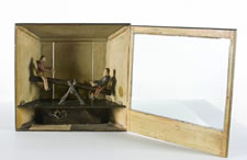 CLOCKWORK ACTION TOY, BOYS ON A SEESAW, WITH A PERIOD, HANDWRITTEN NOTE, ca 1870-80