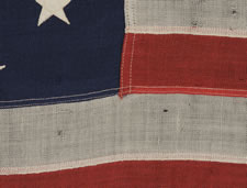 "ANTIQUE PRIVATE YACHT FLAG (ENSIGN) WITH 13 STARS AND A FOULED ANCHOR, MARKED ""U.S. ARMY STANDARD BUNTING"", 1895-1910 ERA"