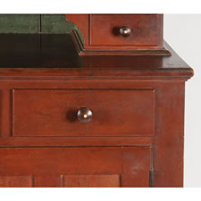 PENNSYLVANIA OR OHIO DUTCH CUPBOARD IN CHERRY, ON MILK BOTTLE FEET, WITH A STRONG, TOMATO RED WASH, BLUE PAINTED INTERIOR, AND INDLAID KNOBS, CA 1835