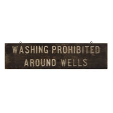 """WASHING PROHIBITED AROUND WELLS"", AN EARLY-MID 20TH CENTURY SIGN"