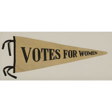 "TRIANGULAR FELT WOMEN'S SUFFRAGETTE PENNANT WITH PRINTED TEXT THAT READS ""VOTES FOR WOMEN"", 1910-1920"