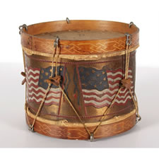PATRIOTIC AMERICAN TOY DRUM WITH OPPOSING FLAGS, PROBABLY SPANISH AMERICAN WAR ERA (1898)