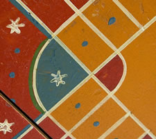 "ORANGE PARCHEESI BOARD WITH WHIMSICAL MEDALLIONS, POLKA DOTS, & SNOWFLAKE STARS (A ""SNOWFLAKE BOARD"")"
