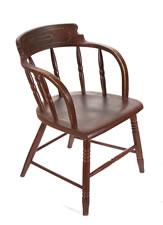 SET OF 12 BARREL-BACK WINDSOR CHAIRS, IN RED PAINT, WITH THE 3-LINK CHAIN (FRIENDSHIP, LOVE, AND TRUTH) OF THE ODD FELLOWS ON EACH CREST RAIL, CA 1850-70
