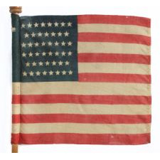 46 STAR U.S. MILITARY CAMP COLORS, PRESS-DYED ON WOOL BUNTING, MADE BY HORSTMANN, PHILADELPHIA, SIGNED AND DATED 1909, ON ITS REMARKABLE, ORIGINAL STAFF