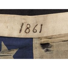 32 STARS (MINNESOTA STATEHOOD), 1858-59, PRESENTED BY A CIVIL WAR MUSICIAN WITH THE 13TH CONNECTICUT INFANTRY, AN UNUSUAL EXAMPLE WITH WOVEN STRIPES AND PRESS-DYED STARS, POSSIBLY MADE IN NEW YORK BY THE ANNIN COMPANY: