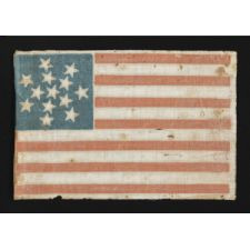 RARE 13 STAR PARADE FLAG DATING TO THE CIVIL WAR PERIOD (1861-65) OR PRIOR, WITH AN EXCEPTIONALLY RARE AND BEAUTIFUL SNOWFLAKE MEDALLION CONFIGURATION OF 13 STARS