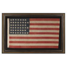 """45 STARS IN A """"NOTCHED"""" DESIGN ON A SMALL SCALE FLAG OF THE 1896-1907 PERIOD, LEAVING SPACE OPEN FOR THE FUTURE ADDITION OF THREE MORE WESTERN TERRITORIES, OWNED AND POSSIBLY MADE BY ALVAH WOODBURY, A SHOEMAKER, OF BEVERLY MASSACHUSETTS"""