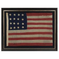 ANTIQUE AMERICAN FLAG WITH 16 STARS, A U.S. NAVY SMALL BOAT ENSIGN OF THE MID-19TH CENTURY, ENTIRELY HAND-SEWN, 1850-1861