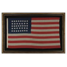 38 HAND-SEWN STARS IN AN UNUSUALLY CONFINED PATTERN OF JUSTIFIED ROWS, ON AN ANTIQUE FLAG IN A RELATIVELY SMALL SCALE FOR THE PERIOD, 1876-1889, COLORADO STATEHOOD