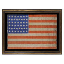 44 STARS IN JUSTIFIED ROWS ON A LARGE SCALE PARADE FLAG WITH STRIKING COLORS AND PLEASANT WEAR, WYOMING STATEHOOD, 1890-1896