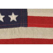 48 STAR, U.S. NAVY SMALL BOAT ENSIGN, MADE AT MARE ISLAND, CALIFORNIA DURING WWII, SIGNED AND DATED 1944, IN THE SMALLEST SCALE EMPLOYED AT THE TIME