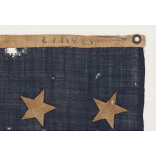 U.S. NAVY JACK WITH 37 STARS, AN ENTIRELY HAND-SEWN EXAMPLE WITH SINGLE-APPLIQUÉD STARS, MADE BY ANNIN IN NEW YORK CITY BETWEEN 1867 AND 1876, RECONSTRUCTION ERA, NEBRASKA STATEHOOD