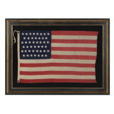 45 HAND-SEWN, SINGLE-APPLIQUED STARS ON THE SMALLEST PIECED-AND-SEWN, COMMERCIALLY-MANUFACTURED, WOOL FLAG THAT I HAVE EVER ENCOUNTERED IN THIS PERIOD, 1896-1908 (UTAH STATEHOOD), MADE AND SIGNED BY THE ANNIN COMPANY IN NEW YORK CITY