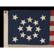 """13 STARS ARRANGED IN A MEDALLION PATTERN, WITH A SLIGHTLY LARGER CENTER STAR, ON A SMALL-SCALE ANTIQUE AMERICAN FLAG MARKED """"NAVY"""" [A BRAND NAME], MADE DURING THE LAST DECADE OF THE 19TH CENTURY"""
