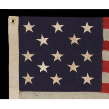 13 STARS ARRANGED IN A 3-2-3-2-3 LINEAL CONFIGURATION ON A SMALL-SCALE ANTIQUE AMERICAN FLAG MADE DURING THE FIRST HALF OF THE 1890's