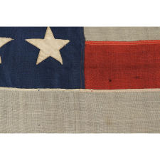 "42 STARS ARRANGED IN A RARE VARIATION OF A NOTCHED DESIGN, WITH SPACES FOR 3 MORE STARS ON BOTH THE HOIST AND FLY ENDS, AN UNOFFICIAL STAR COUNT, WASHINGTON STATEHOOD, 1889-1890, SIGNED ""J. & F.A. WAGNER, MAKER,"" CLEVELAND, OHIO"
