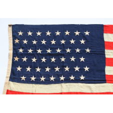 47 STARS ON AN ANTIQUE AMERICAN FLAG MADE TO REFLECT NEW MEXICO STATEHOOD, AN EXTREMELY SCARCE EXAMPLE, NEVER AN UNOFFICIAL STAR COUNT, CA 1912