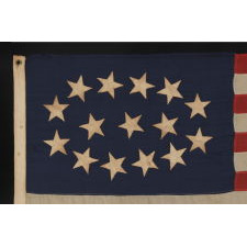 ESPECIALLY RARE 15-STAR FLAG WITH AN EQUALLY RARE AND BEAUTIFUL ELLIPTICAL CONFIGURATION, MADE SOMETIME DURING THE MID-LATE 19TH CENTURY, PERHAPS TO GLORIFY KENTUCKY AS THE 15TH STATE