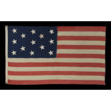 13 CANTED, HAND-SEWN STARS IN A 3-2-3-2-3 PATTERN, ON AN ANTIQUE AMERICAN FLAG MADE IN THE ERA OF THE 1876 CENTENNIAL OF AMERICAN INDEPENDENCE