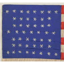 47 NEEDLEWORK STARS ON A SMALL HOMEMADE PARADE FLAG CONSTRUCTED OF SILK TAFFETA AND RIBBON, A RARE AND UNOFFICIAL STAR COUNT, NEW MEXICO STATEHOOD, 1912
