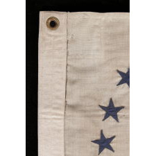 REVENUE CUTTER SERVICE ENSIGN WITH A BLUE EAGLE AMID AN ARCH OF 13 BLUE STARS, ON A WHITE FIELD, AND 16 VERTICAL RED AND WHITE STRIPES, CA 1890-1900