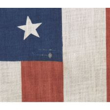 38 STARS IN A MEDALLION CONFIGURATION WITH 2 OUTLIERS, A RARE EXAMPLE OF THIS PATTERN ON A LARGE SCALE PARADE FLAG WITH RED STRIPES, 1876-1889, COLORADO STATEHOOD
