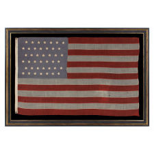 42 HAND-SEWN STARS ON SMALL SCALE FLAG WITH A DUSTY BLUE CANTON, AN UNOFFICIAL STAR COUNT, WASHINGTON STATEHOOD, 1889-1890
