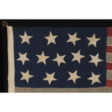 "13 HUGE STARS, HAPHAZARDLY CONFIGURED IN A 4-5-4 PATTERN, ON A STRIKINGLY GRAPHIC FLAG OF THE CIVIL WAR ERA, MARKED ""BIG BAY"" AND PROBABLY EMPLOYED IN U.S. ARMY OR NAVY SERVICE"