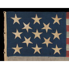 13 LARGE AND STRIKINGLY VISUAL STARS ON A U.S. NAVY SMALL BOAT ENSIGN, ENTIRELY HAND-SEWN, CA 1884-87