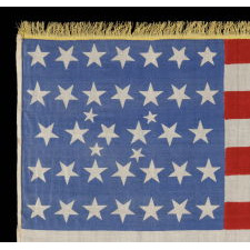 38 STARS IN AN EXTREMELY RARE LINEAL CONFIGURATION THAT HAS 4 TINY STARS EMBEDDED IN THE PATTERN, FORMERLY IN THE COLLECTION OF RICHARD PIERCE AND PICTURED IN HIS TEXT ON FLAG COLLECTING