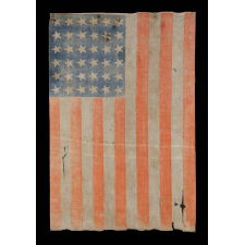 36 STAR ANTIQUE AMERICAN PARADE FLAG OF THE CIVIL WAR ERA, IN AN ESPECIALLY LARGE SCALE AND WITH ENDEARING WEAR, 1864-67, NEVADA STATEHOOD