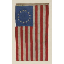 13 HAND-EMBROIDERED STARS AND EXPERTLY HAND-SEWN STRIPES, ON A FLAG MADE BY SARAH M. WILSON, GREAT-GRANDDAUGHTER OF BETSY ROSS, IN PHILADELPHIA IN 1904