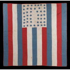 AMERICAN PATRIOTIC FLAG QUILT WITH 44 BLUE STARS SET UPON A WHITE GROUND IN THE TOP CENTER OF 13 RED, WHITE, AND BLUE STRIPES, 1890-1896, WYOMING STATEHOOD