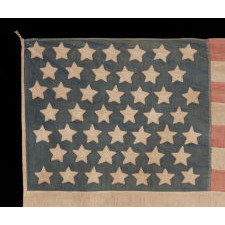 46 STARS ON A COTTON FLAG WITH AN UNUSUAL LINEAL PATTERN OF STARS IN 7 ROWS, PROBABLY OF HOMEMADE ORIGIN, WITH BEAUTIFUL WEAR AND PRESENTATION, OKLAHOMA STATEHOOD, 1907-1912