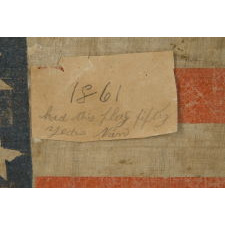 25 STARS IN A VERY RARE LINEAL ARRANGEMENT THAT FEATURES A LARGE CENTER STAR, SOUTHERN-EXCLUSIONARY, THE ONLY KNOWN EXAMPLE IN THIS STYLE AND THE ONLY 19TH CENTURY PARADE FLAG IN THIS STAR COUNT