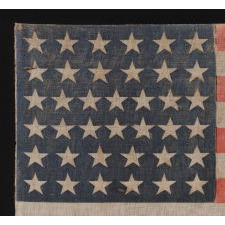 38 STARS ON AN ANTIQUE AMERICAN FLAG, MADE DURING THE PERIOD WHEN COLORADO WAS THE MOST RECENT STATE ADDED TO THE UNION, 1876-1889