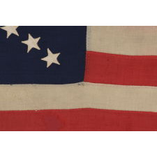 38 STARS ON AN ENTIRELY HAND-SEWN FLAG WITH A DYNAMIC STARBURST CROSS, ONE OF THE MOST RARE & VISUALLY SPECTACULAR CONFIGURATIONS IN FLAG COLLECTING; ONCE BELONGING TO IRA SWARTZ OF PENNSYLVANIA, A CAREER SOLDIER WHO SERVED WITH THE FAMED 1ST MICHIGAN CAVALRY DURING THE CIVIL WAR; MADE CA 1876-1889