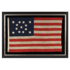 13 HAND-SEWN STARS IN A BEAUTIFUL MEDALLION CONFIGURATION ON A SMALL SCALE ANTIQUE AMERICAN FLAG OF THE 1876 CENTENNIAL ERA