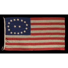 17 STARS IN AN OVAL MEDALLION WITH 2 STARS IN THE CENTER, A MID-19TH CENTURY FLAG WITH A RARE STAR COUNT, IN AN EXTRAORDINARY CONFIGURATION, AND IN A DESIRABLE SMALL SCALE AMONG ITS COUNTERPARTS OF THE PERIOD; MADE CA 1850-1865, LIKELY TO COMMEMORATE OHIO AS THE 17TH STATE