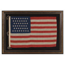 44 STARS IN ZIGZAGGING ROWS ON A SMALL SCALE ANTIQUE AMERICAN FLAG WITH PIECED-AND-SEWN CONSTRUCTION, WYOMING STATEHOOD, 1890-1896