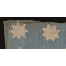 EXTRAORDINARY, HAND-SEWN, 13 STAR AMERICAN NATIONAL FLAG WITH 8-POINTED STARS ON A GLAZED COTTON, CORNFLOWER BLUE, 12 STRIPES, AND ITS CANTON RESTING ON THE WAR STRIPE, FOUND IN UPSTATE, NEW YORK, PRE-CIVIL WAR, CA 1830-1850