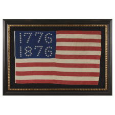"ANTIQUE AMERICAN FLAG WITH 10-POINTED STARS THAT SPELL ""1776-1876"", MADE FOR THE 100-YEAR ANNIVERSARY OF AMERICAN INDEPENDENCE, ONE OF THE MOST GRAPHIC OF ALL EARLY EXAMPLES"