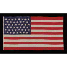 "45 STARS IN LINEAR ROWS, WITH ""DANCING"" OR ""TUMBLING"" ORIENTATION, ON A LARGE SCALE PARADE FLAG WITH AN ELONGATED PROFILE, 1896-1908, SPANISH-AMERICAN WAR ERA, UTAH STATEHOOD"